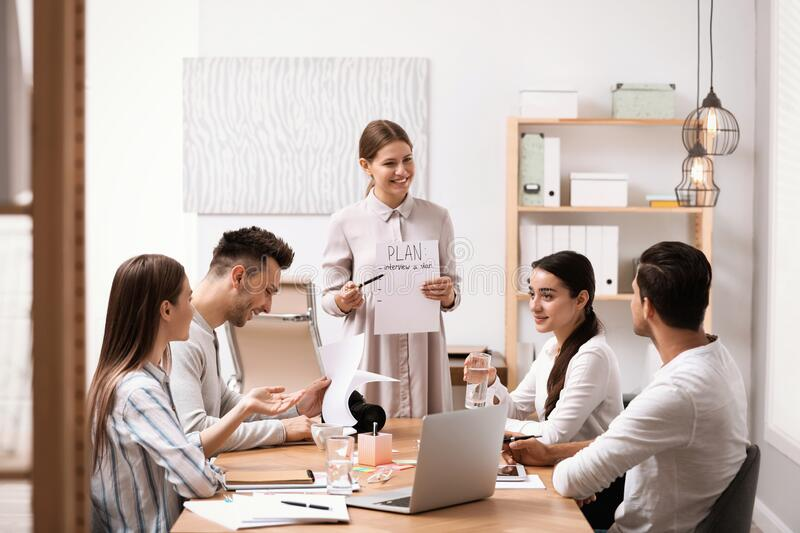 Team of professional journalists working stock images