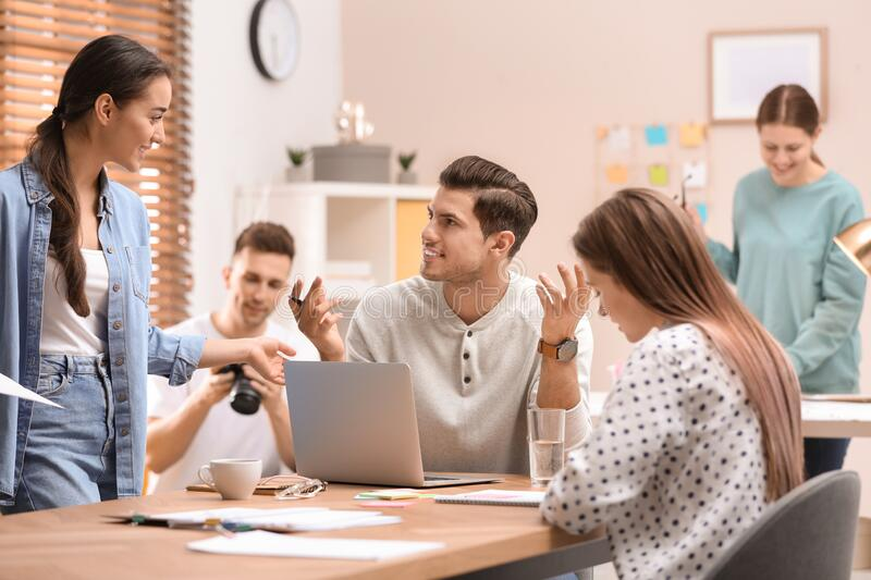 Team of professional journalists working stock image