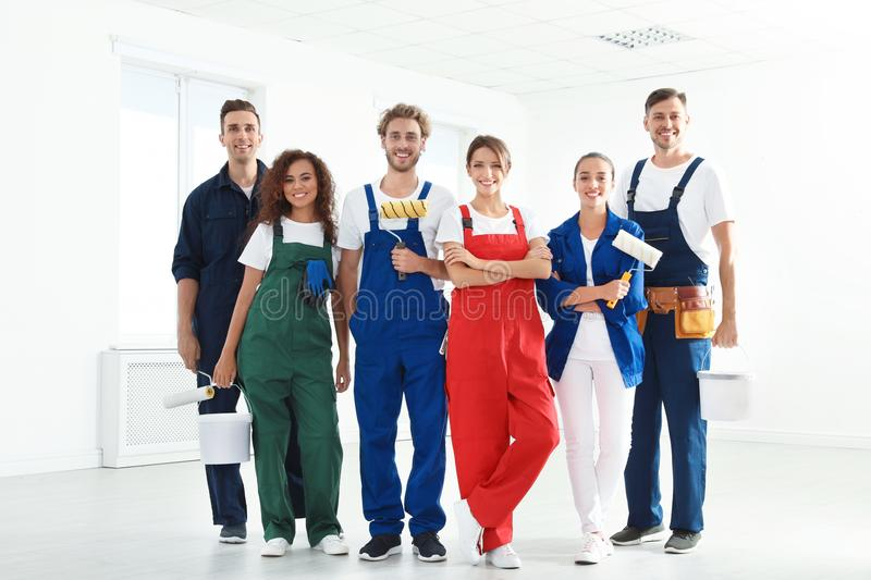 Team of professional painters with tools royalty free stock image