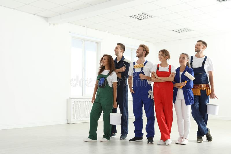 Team of professional painters with tools working royalty free stock photo