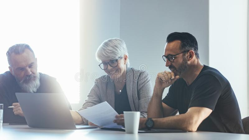 Team of professionals discussing new project stock photos