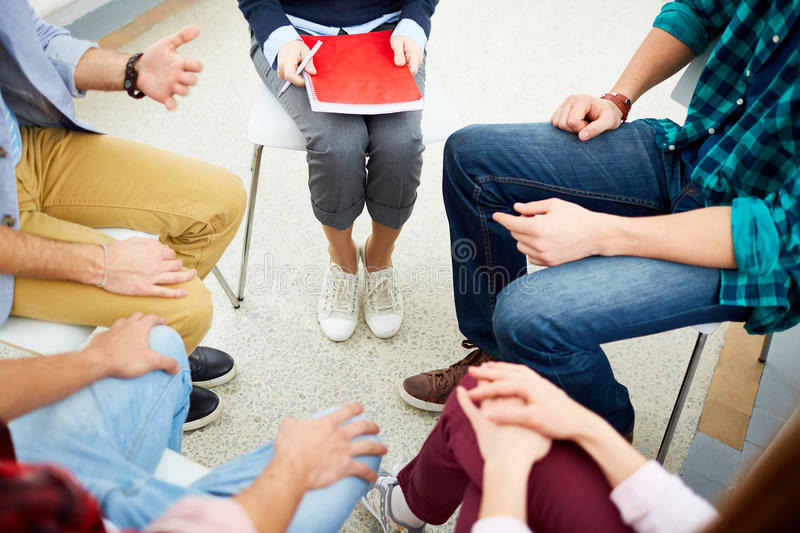 Team of psychologists. Group of students telling their stories at psychological course royalty free stock photo