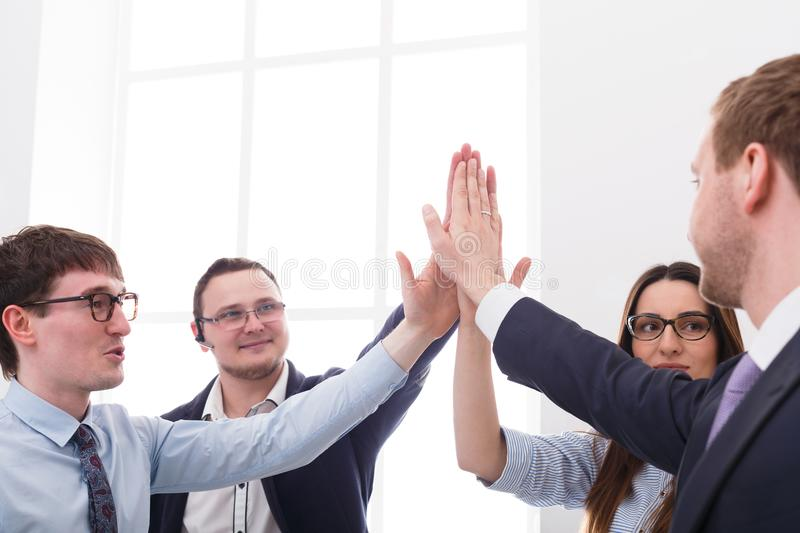 Team put hands together, connection, teambuilding and alliance concept. Closeup, crop. Closeup of successful people in office, young businessmen and women unite stock image