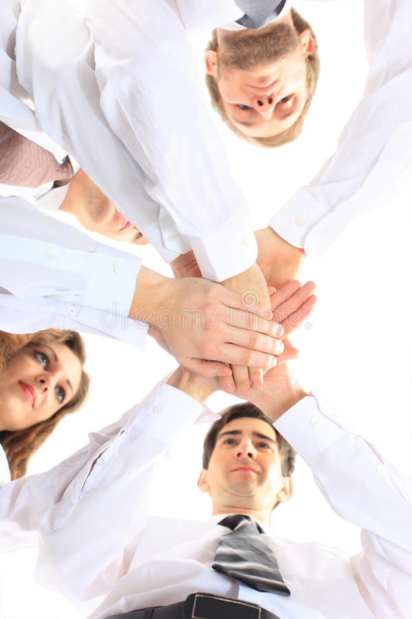 Team putting their hands. Business team putting their hands on top of each other stock photography
