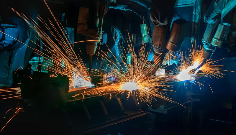 Team robots are welding assembly part in car factory royalty free stock photos