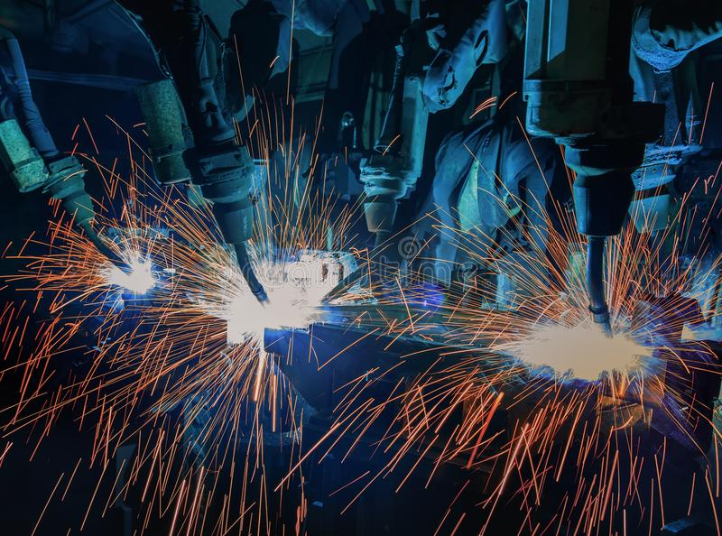 Team robots are welding part in automotive industrial factory royalty free stock photography