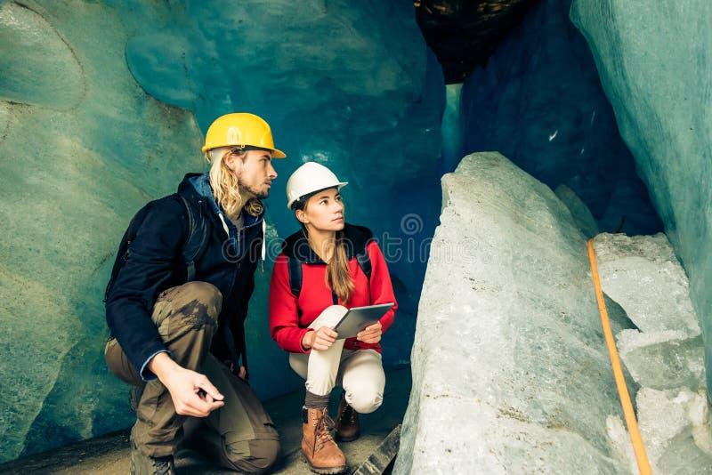 Team Of Scientists Examining A Glacier royalty free stock photo