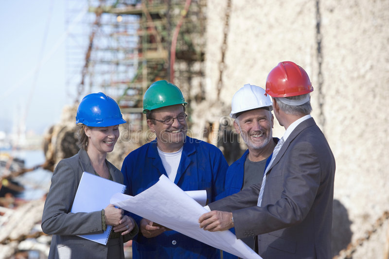 A team of shipping engineers stock photography