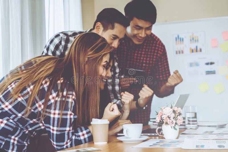 Team showing team work success winning gesture in business team stock photos
