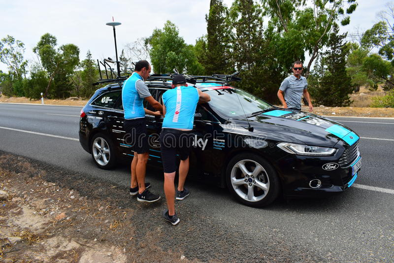 Team Sky Crew Members La Vuelta España. The crew prepare drinks and food for their approaching cyclists in La Vuelta Espana stage 8 stock photo