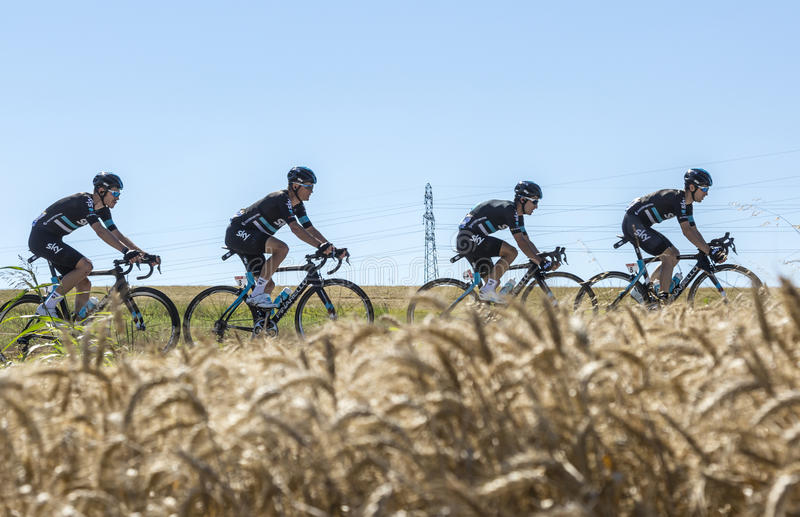 Team Sky in the Plain - Tour de France 2016. Saint-Quentin-Fallavier,France - July 16, 2016: Four cyclists of Team Sky, riding in a wheat plain during the stage stock photography