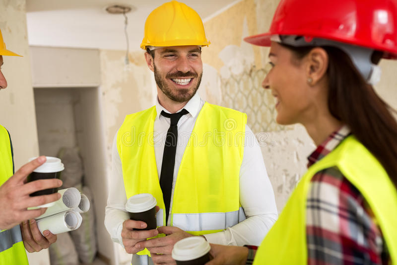Team of smiling architects at coffee break royalty free stock images