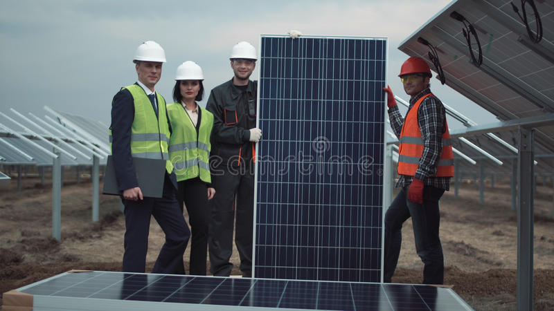 Team with solar panel stock images