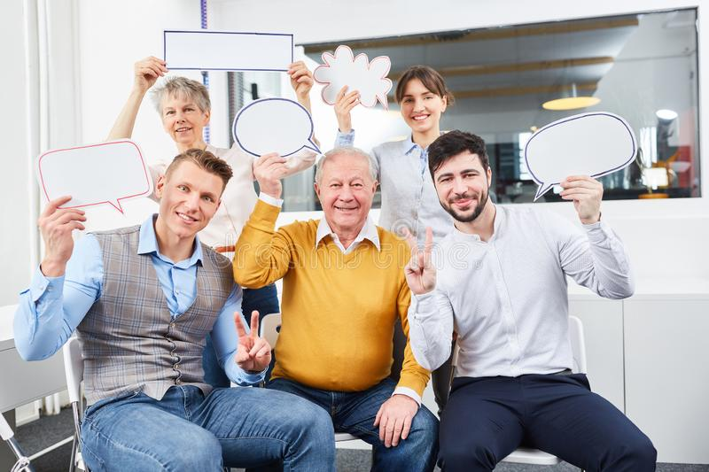 Team with speech bubbles. Business team with speech bubbles for talk and communication royalty free stock photos