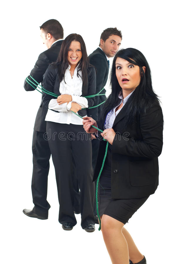 Team is stronger than a single person. Surprised businesswoman trying to pulling a group of businesspeople but they are stronger than woman,concept of a team is stock image