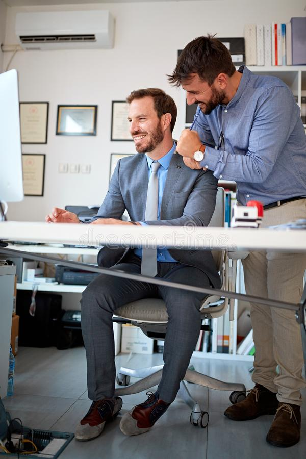 Team of successful business men in a meeting royalty free stock photo