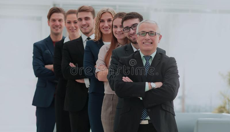 The team of the successful people with their mature boss stock images