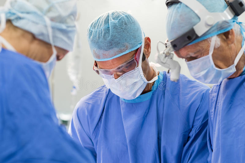 Team Of Surgeons Operating photos stock