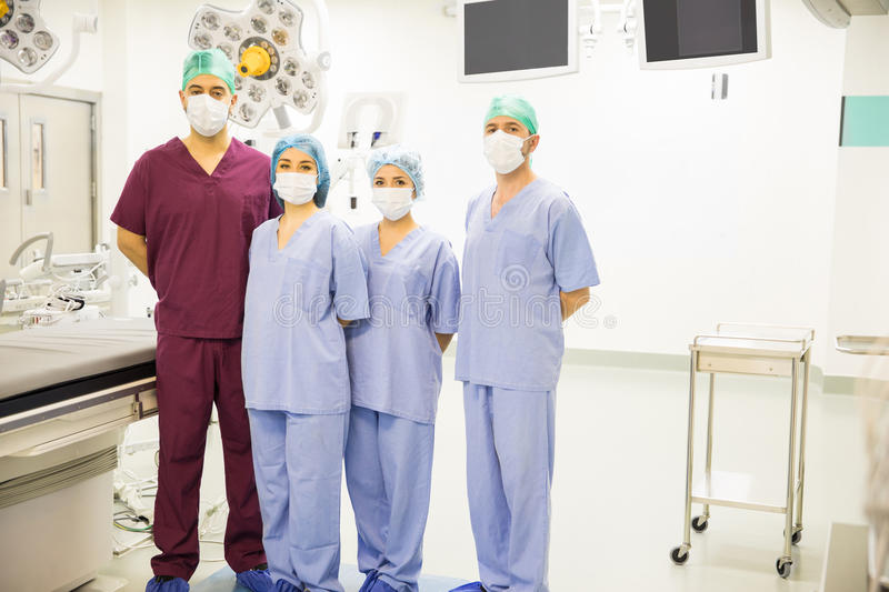 Team of surgeons in an operating room royalty free stock image