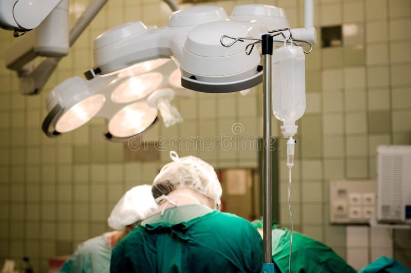 Team of surgeons at work stock photo