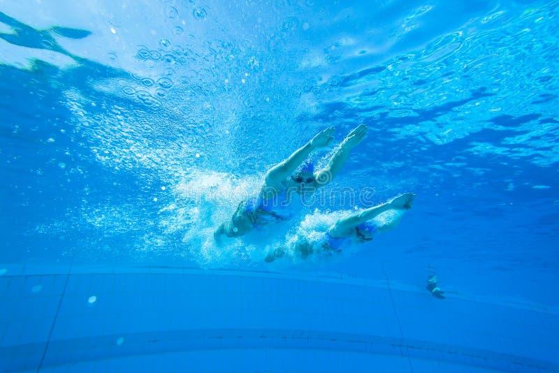 Team Swimming Girls synchronisé photo stock