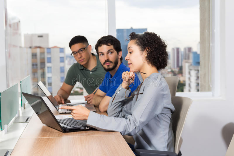 Team talks about project in office stock photos