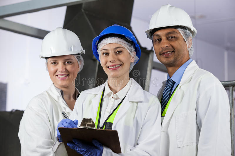 Team of technicians standing in meat factory. Portrait of technicians standing in meat factory stock images