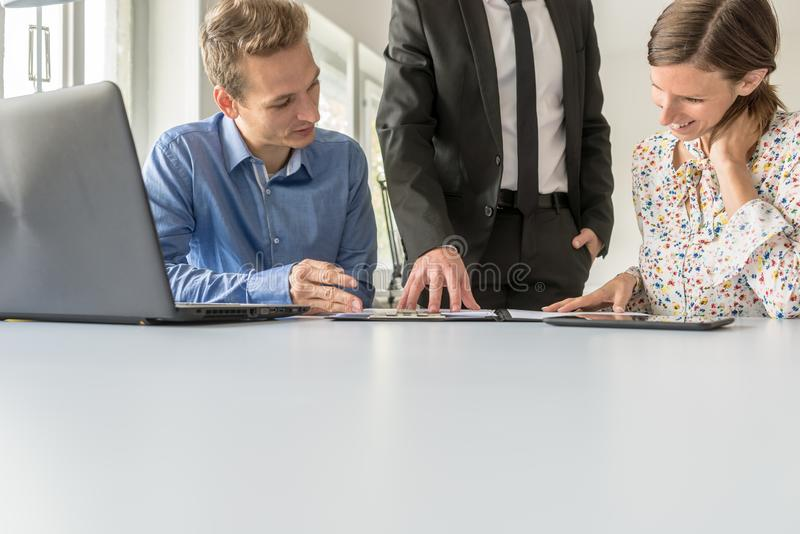 Team of three business people working together royalty free stock photos