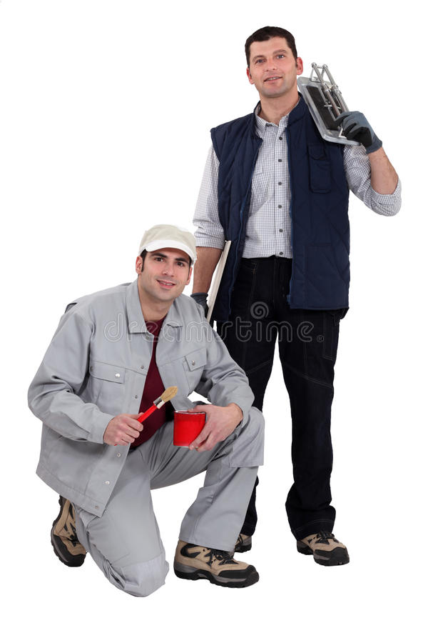 A team of tradesmen. Posing with their tools stock photo