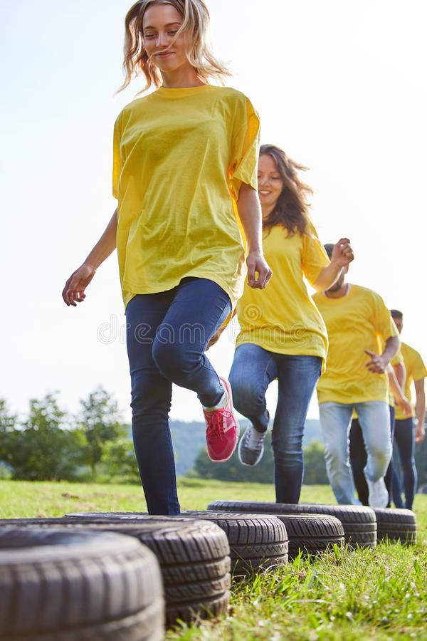 Team trains fitness and coordination. Sporting team trains fitness and coordination at a teambuilding event stock photo