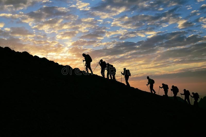 Trekkers and Sunrise stock images