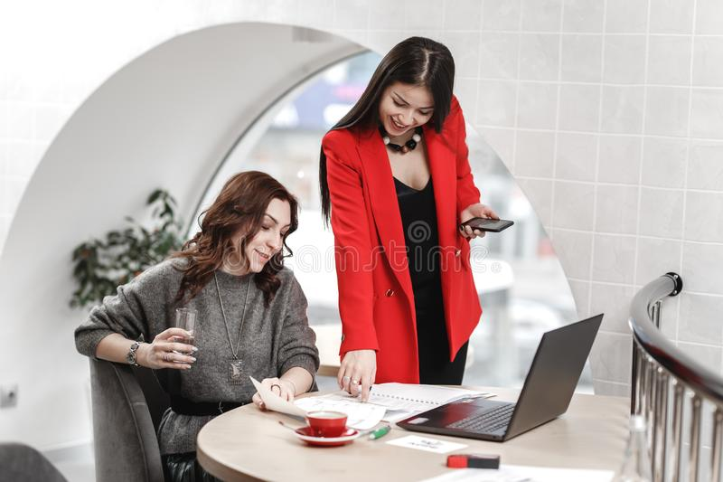 Team of two interior designers stylish young women are working in the office at the design project stock images
