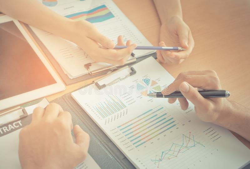 Team of two worker Business analyzing data on the table stock photo