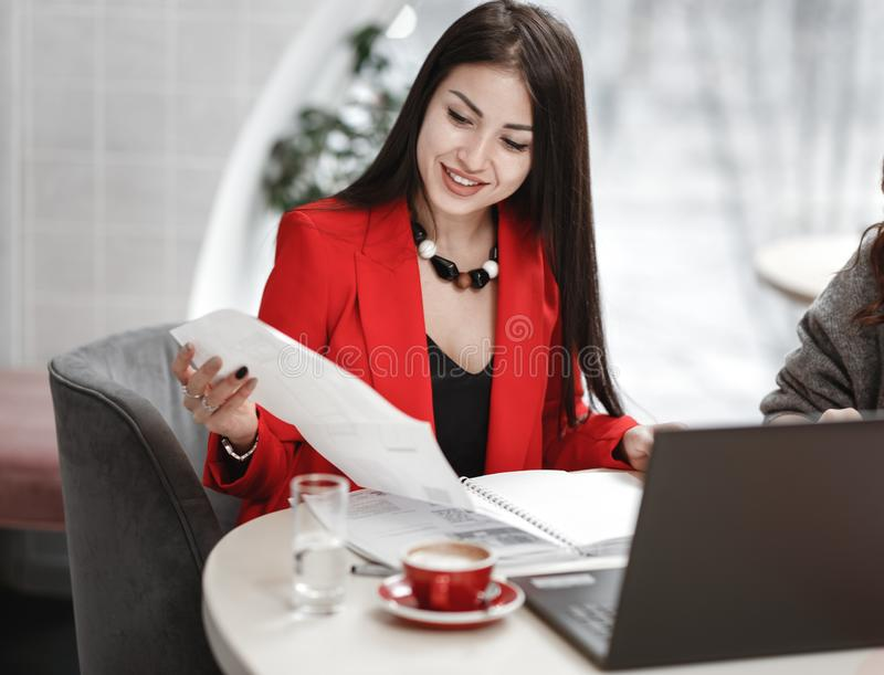 Team of two young women designer are working at the design project of interior sitting at the desk with laptop and royalty free stock photos