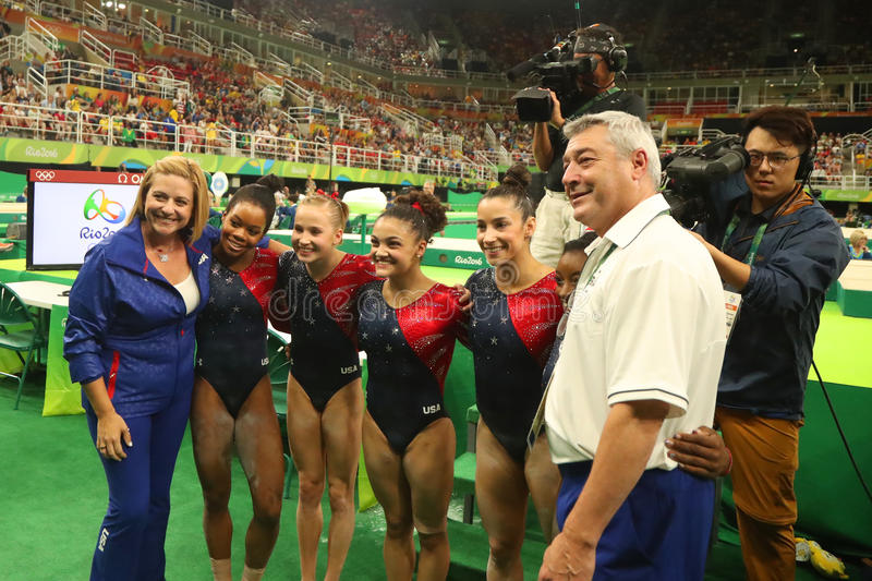 Team United States with coaches after women`s all-around gymnastics qualification at Rio 2016 Olympic Games. RIO DE JANEIRO, BRAZIL - AUGUST 7, 2016: Team United royalty free stock photo