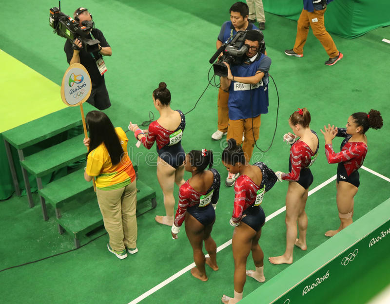 Team United States during women`s all-around gymnastics qualification at Rio 2016 Olympic Games. RIO DE JANEIRO, BRAZIL - AUGUST 7, 2016: Team United States royalty free stock image