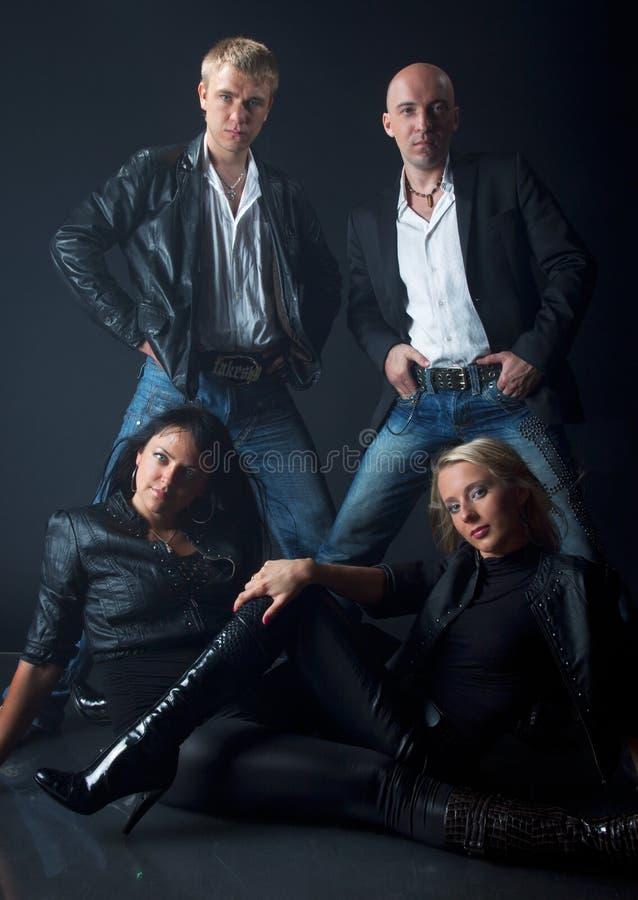 Team van twee mannen en twee vrouwen royalty-vrije stock afbeelding