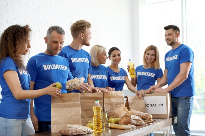 Team of volunteers collecting food donations stock images