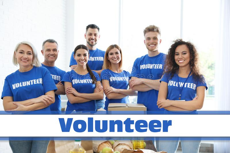 Team of volunteers near table with food donations stock photos