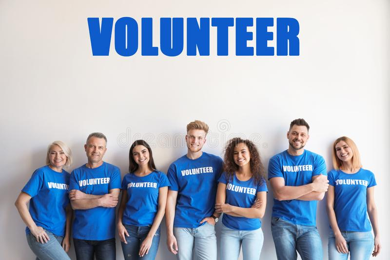 Team of volunteers in uniform on background royalty free stock photo