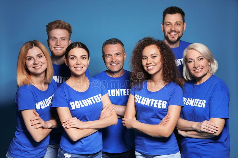 Team of volunteers in uniform royalty free stock photography