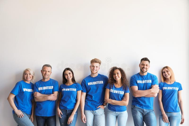 Team of volunteers in uniform royalty free stock photo