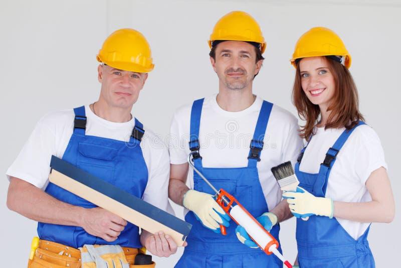 Team von Arbeitern stockbild