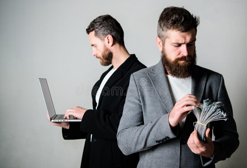 Team of web developer with laptop and sales manager with cash money. Developing applications. Digital technology. IT stock image