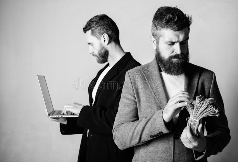 Team of web developer with laptop and sales manager with cash money. Developing applications. Digital technology. IT royalty free stock photos