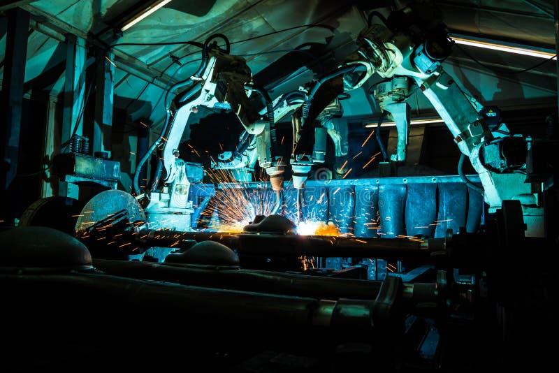 Team welding robots represent the movement. stock images