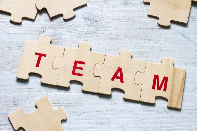 Team word background business concept on puzzle. Abstract stock photography