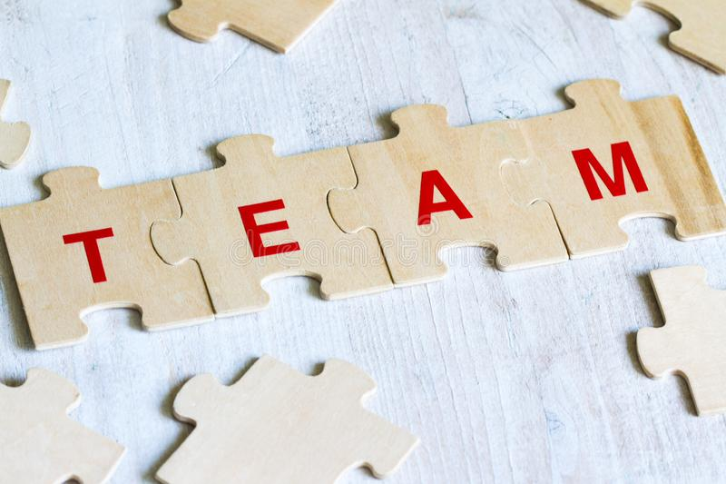 Team word background business concept on puzzle stock images