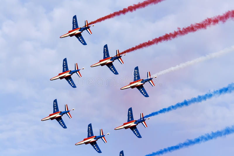 Team work. The fly by of Patrouille de France acrobatic aircraft team during the International Air Show on 28.08.2011 in Radom, Poland stock photo
