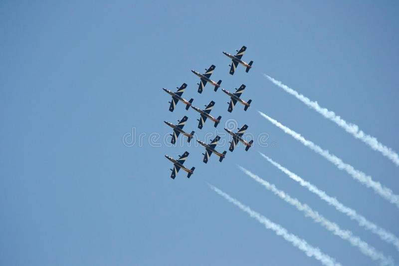 Team work. Team of nine airplanes flying together on air show, concept of teamwork stock image